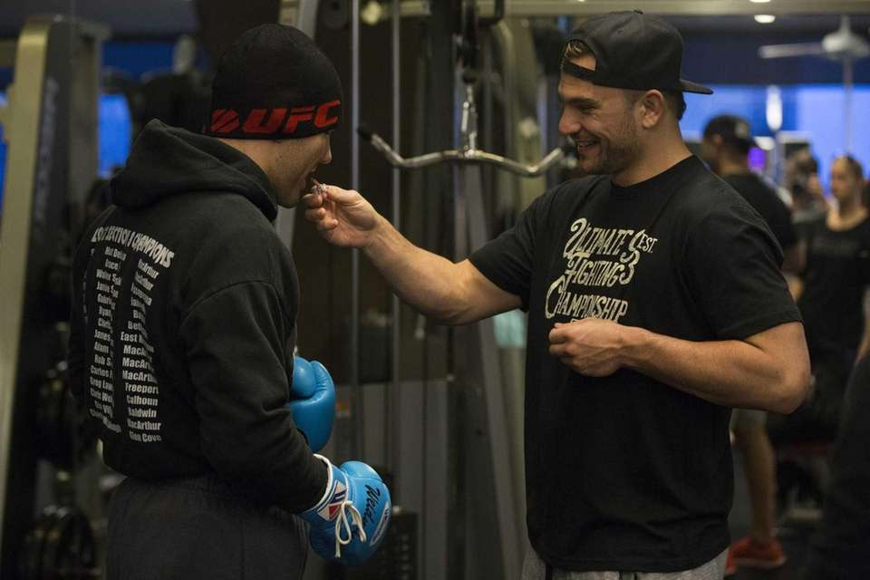 Gian Villante, from Levittown, feeds chewing gum to