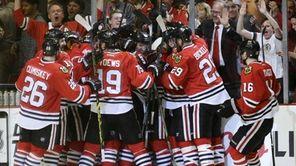 Chicago Blackhawks players celebrate Antoine Vermette's goal against