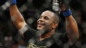 Daniel Cormier celebrates after defeating Anthony Johnson in