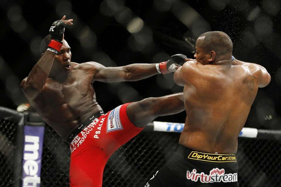 Anthony Johnson kicks Daniel Cormier during their light