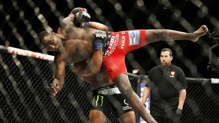 Daniel Cormier lifts Anthony Johnson during their light