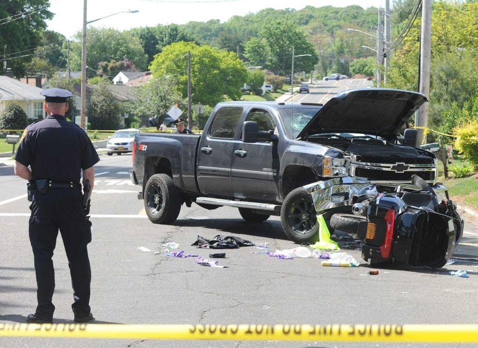 Police investigate the scene of an accident involving