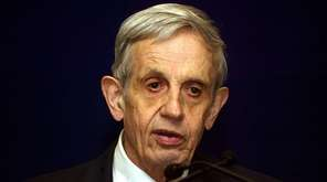 John Nash is shown speaking in New Delhi,