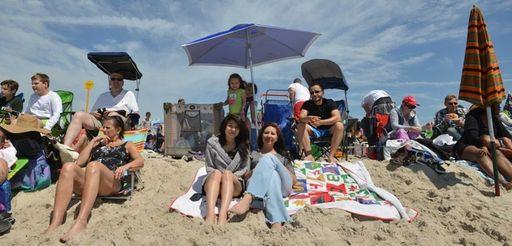 Brenda Escobar, center left, and her mother Cristina