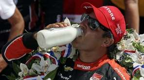 Juan Pablo Montoya celebrates after winning the 99th