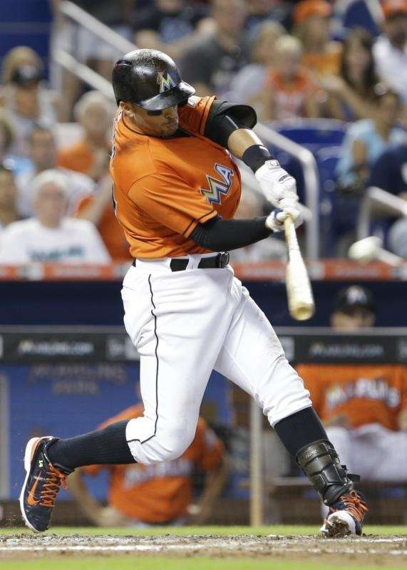 The Miami Marlins' Martin Prado hits a solo