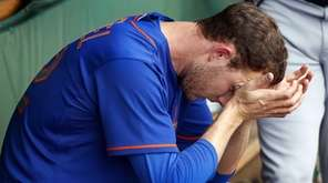 New York Mets relief pitcher Erik Goeddel sits
