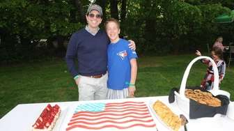 Eric and Cooper Malley attend the annual Memorial