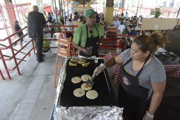 Local vendors prepare meals at East Harlem's La