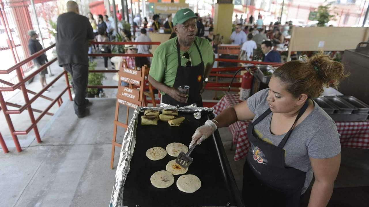 Local vendors prepare meals at East Harlem's La