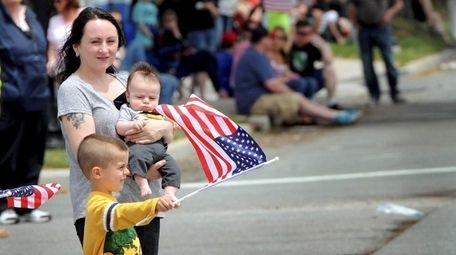 Adela Elliott of Centereach and her sons, Lucas,