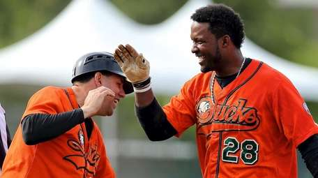 Long Island Ducks manager Kevin Baez congratulates Prentice