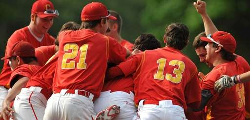 Chaminade teammates celebrate after their extra innings win