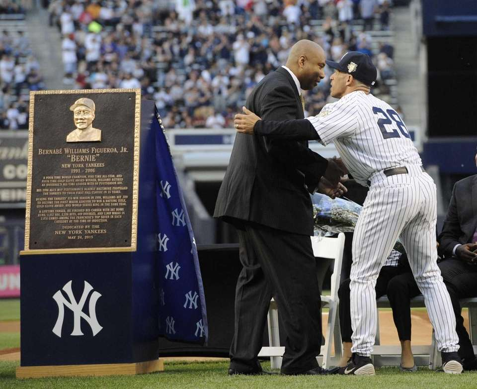 Former New York Yankees Bernie Williams is congratulated