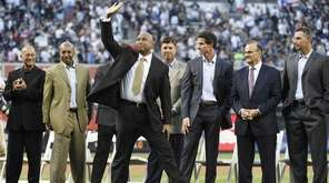 Former New York Yankees centerfielder Bernie Williams waves
