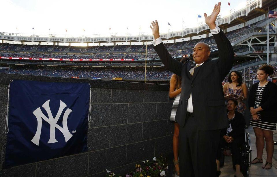 Former New York Yankees centerfielder Bernie Williams waves
