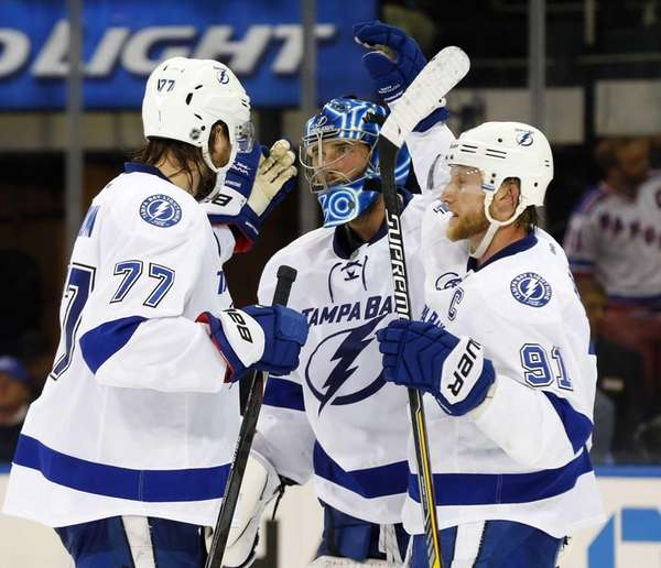 Ben Bishop #30, Victor Hedman #77 and Steven