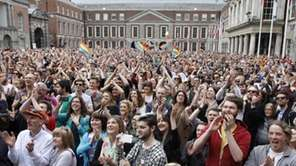 Yes supporters react at Dublin castle, Ireland, Saturday,