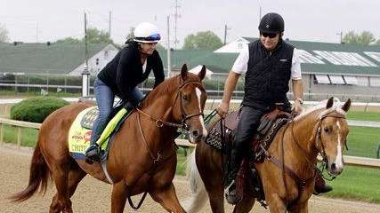 Exercise rider Dana Barnes and assistant trainer Jimmy
