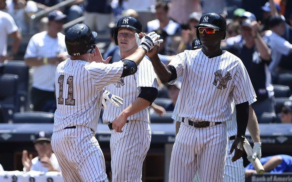 New York Yankees leftfielder Brett Gardner, left, is