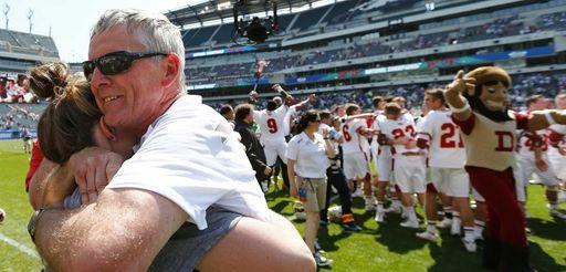 Denver's head coach Bill Tierney gets a hug