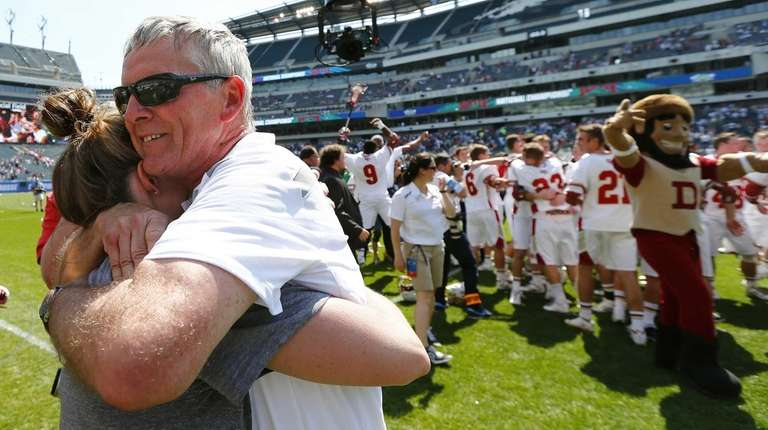 Denver's head coach Bill Tierney gets a hug