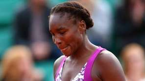 A dejected Venus Williams looks on during her