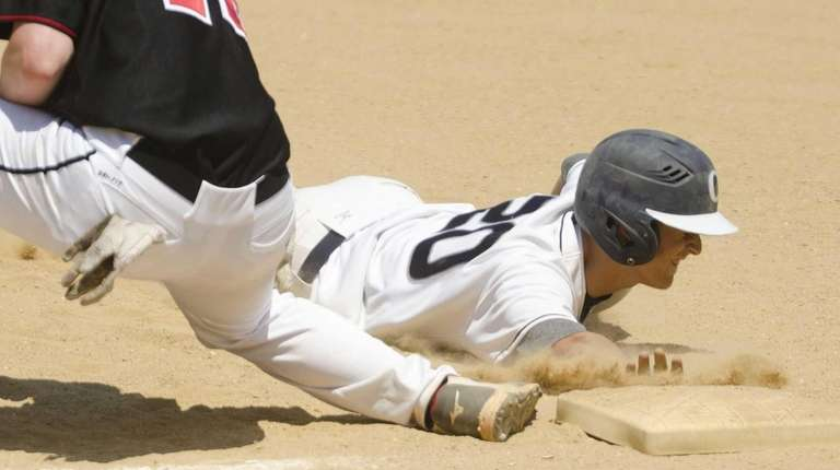 Oceanside's Dylan Judd (#20) avoids getting tagged out