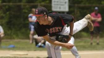 Syosset's Derek Spillane delivers a pitch during a