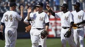 The New York Yankees celebrate their 14-1 win