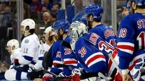 Henrik Lundqvist looks on from the bench in