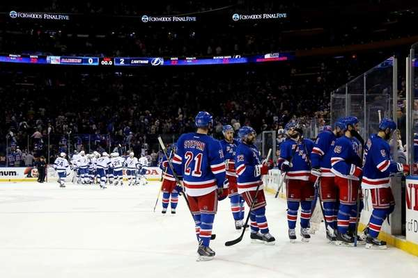 The New York Rangers leave the ice after