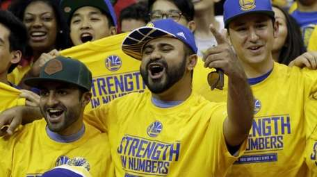 Golden State Warriors fans cheer before Game 4