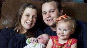 Josh and Anna Duggar with their daughter Mackynzie