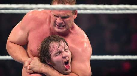 WWE Superstar Kane holds a chin lock on