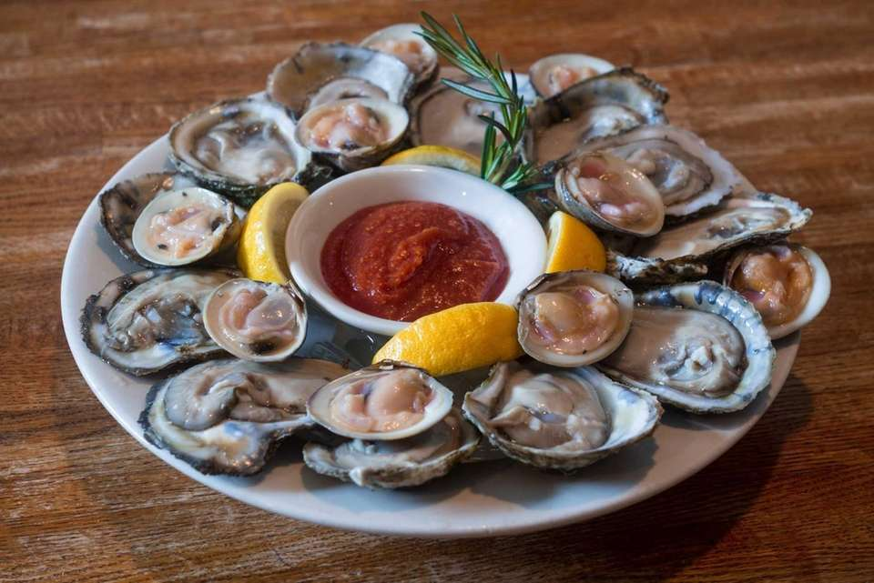 Raw clams and oysters served on a half