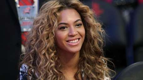 Beyonce sits courtside before the NBA All-Star basketball