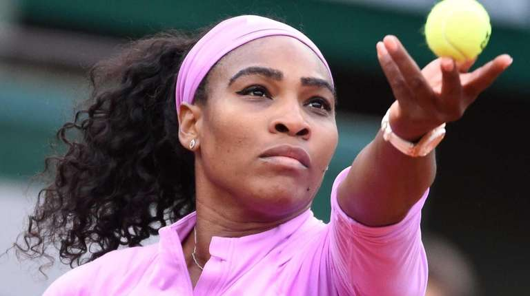 Serena Williams serves to Andrea Hlavackova during the