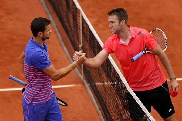 Jack Sock is congratulated on his victory at