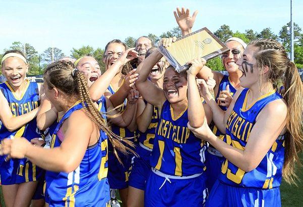 The West Islip girls lacrosse team celebrates its