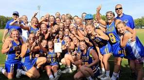 The West Islip girls lacrosse team celebrates its