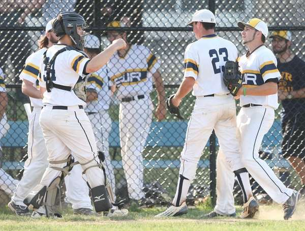 Shorham-Wading River players congratulate one another after beating