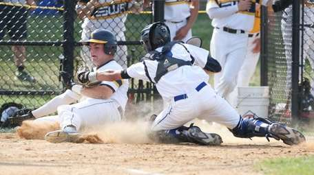 Shorham-Wading River's Dalten Stalzer (32) gets tagged out