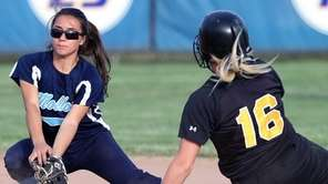 St. Anthony's Kim Puzo safely slides into second