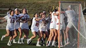 The Mt. Sinai girls lacrosse team mobs its
