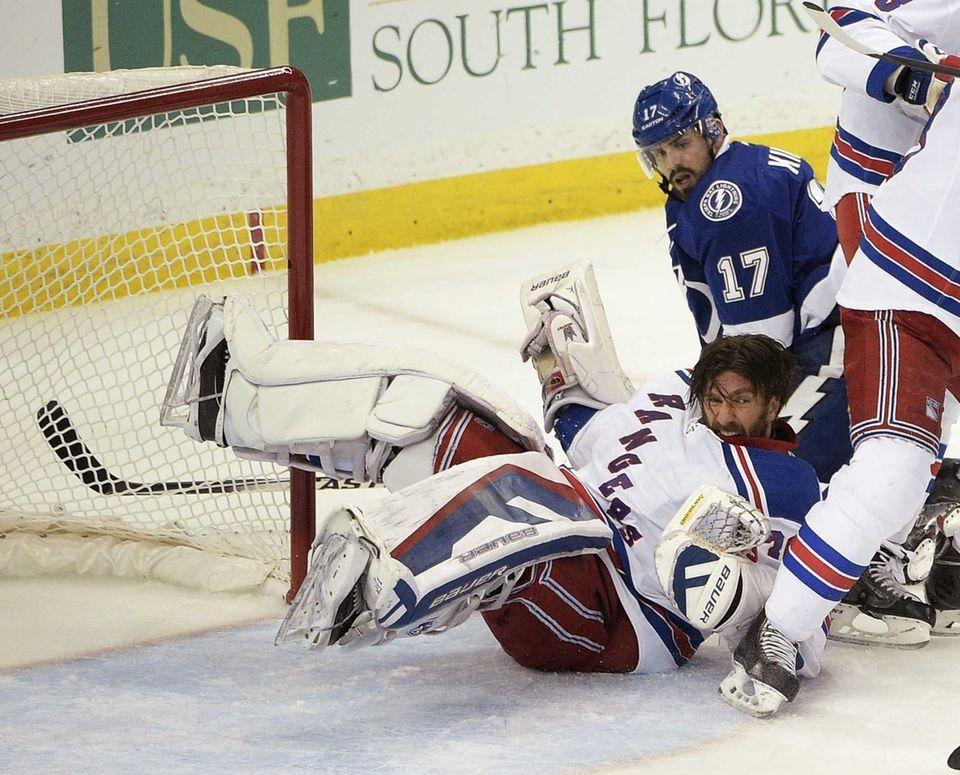 New York Rangers goalie Henrik Lundqvist (30) falls