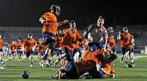 Manhasset rushes its goalie Michael Niebler after defeating