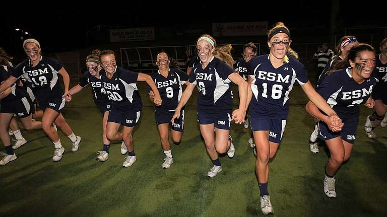 The Eastport-South Manor girls lacrosse team charges across