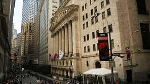 Visitors gather outside the New York Stock Exchange