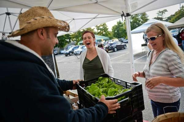 Thera Farms owner Teddy Bolkas, left, sells Boston